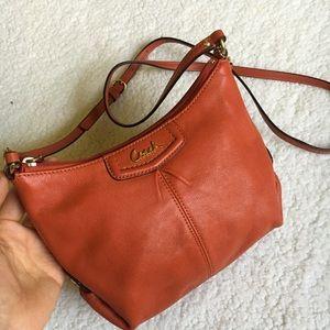 Genuine leather, genuine Coach mini purse.